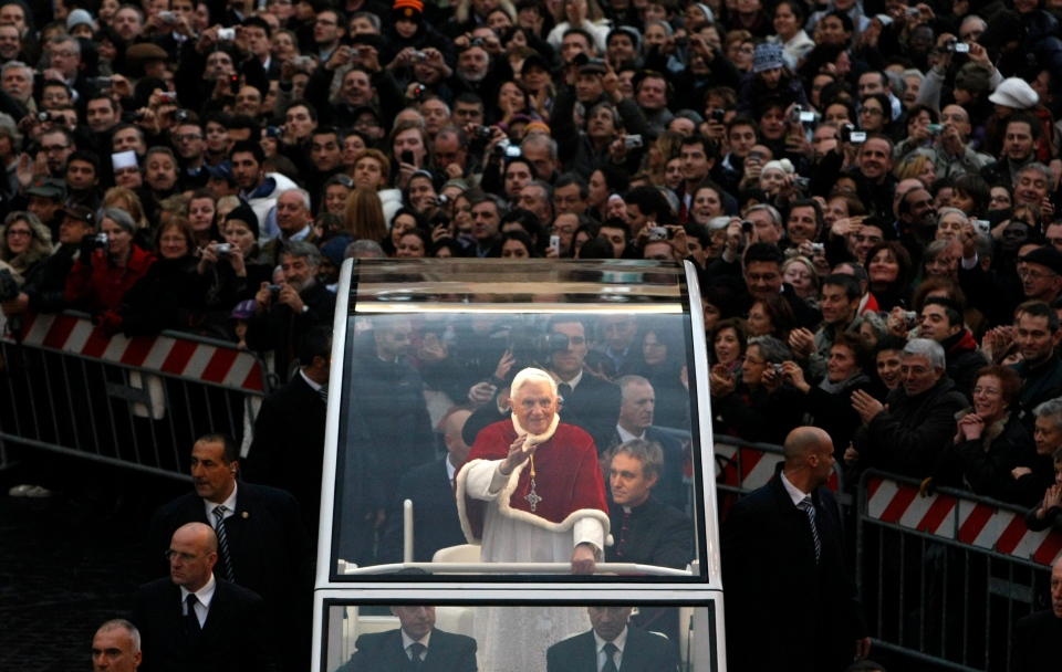 Pope Benedict XVI, standing at centre, waves from his popemobile on his way to the Spanish Steps in central Rome in this 2009 file photo. (AP Photo/Andrew Medichini)