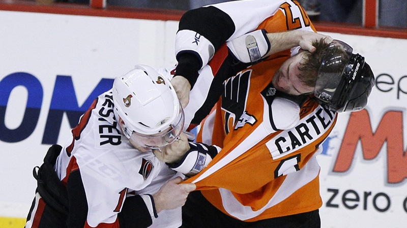 Ottawa Senators' Jesse Winchester (18) and Philadelphia Flyers' Jeff Carter (17) fight during the third period of an NHL hockey game, Thursday, Jan. 20, 2011, in Philadelphia. The Flyers won 6-2. (AP Photo/Matt Slocum)