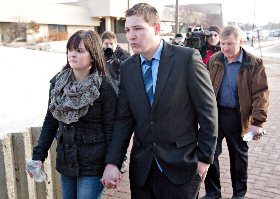 Brenden Holubowich walks with supporters as he makes his way to the courthouse for sentencing in the deaths of four high school football players, in Grande Prairie Alta., on Tuesday, Feb. 26, 2013. (Jason Franson / THE CANADIAN PRESS)