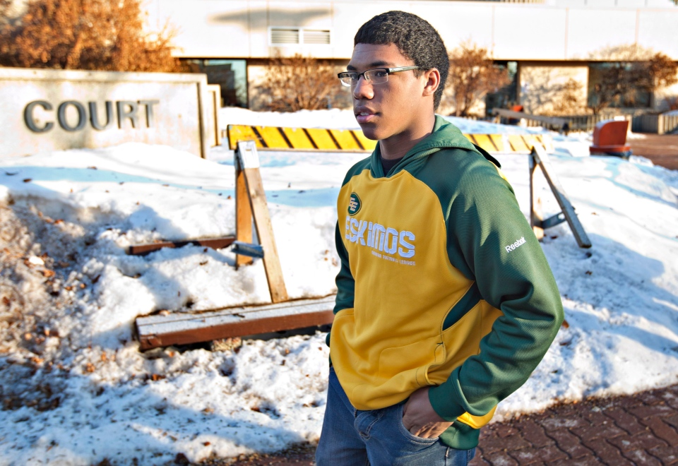 Zach Judd, the lone survivor of an accident that killed four of his teammates, walks into court to attend the sentencing of Brenden Holubowich, charged in the deaths of four high school football players, in Grande Prairie Alta., on Tuesday, Feb. 26, 2013. (Jason Franson / THE CANADIAN PRESS)