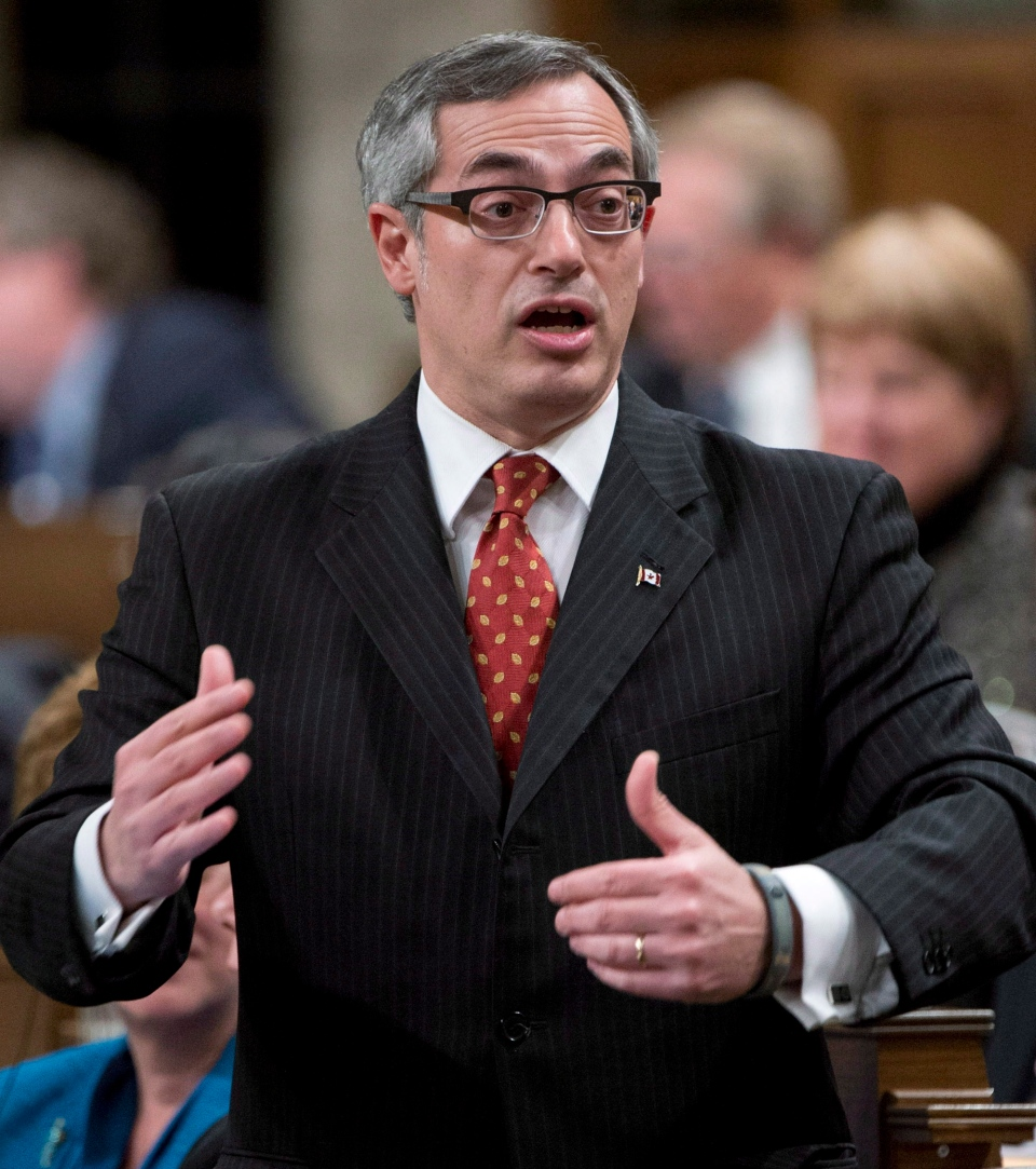 Treasury Board President Tony Clement responds to a question during question period in the House of Commons in Ottawa, Monday, Feb. 25, 2013. (Adrian Wyld / THE CANADIAN PRESS)