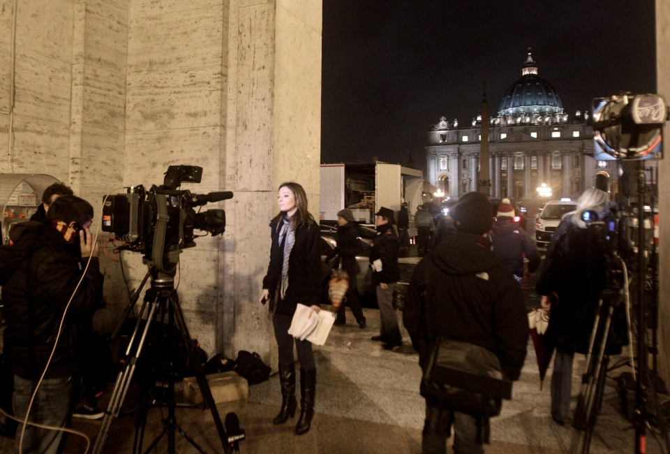 Media gather in front of St. Peter's square