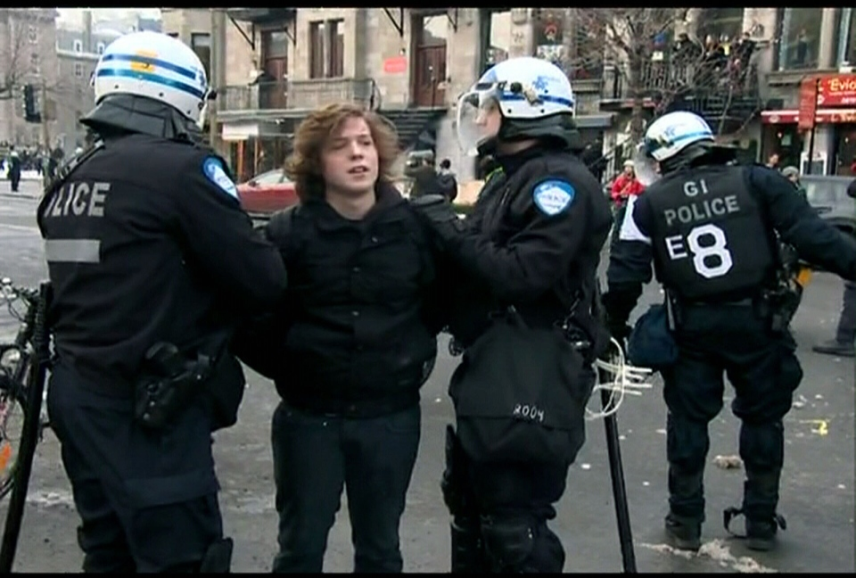 Police officers arrest a protester during a student rally in Montreal on Tuesday, Feb. 26, 2013.