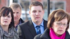 Brenden Holubowich walks with supporters as he makes his way to the courthouse for sentencing in the deaths of four high school football players, in Grande Prairie, Alta., on Tuesday, Feb. 26, 2013. (Jason Franson/THE CANADIAN PRESS)