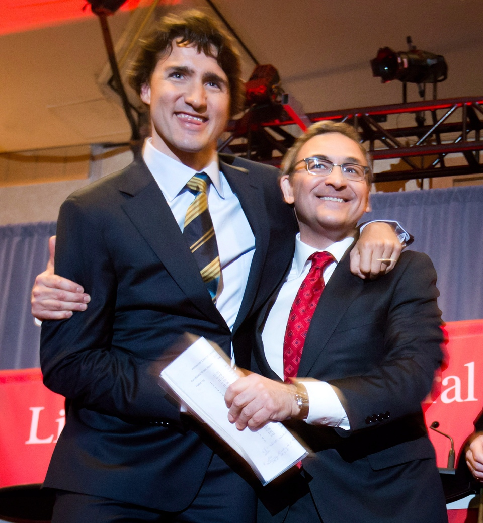 Federal Liberal leadership candidates Justin Trudeau, left, and Martin Cauchon embrace after the party's first leadership debate in Vancouver, B.C., on Sunday January 20, 2013. (Darryl Dyck / THE CANADIAN PRESS)