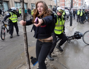 Police officers and protesters clash