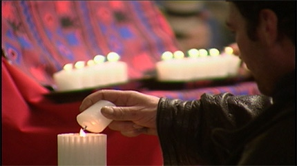 A man lights a candle in honour of a lost love one during a ceremony held on Saturday January 22nd, 2011.