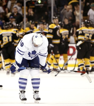 Toronto Maple Leafs' Nik Antropov bends over at centre ice as the Boston Bruins celebrate behind him after they defeated Toronto 4-2 in Boston on Thursday, March 27, 2008. (AP Photo / Winslow Townson)