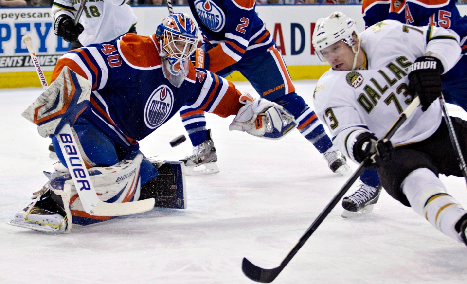 Dallas Stars' Michael Ryder (73) is stopped by Edmonton Oilers goalie Devan Dubnyk during first period NHL hockey action in Edmonton, Alta., on Tuesday February 12, 2013. THE CANADIAN PRESS/Jason Franson.