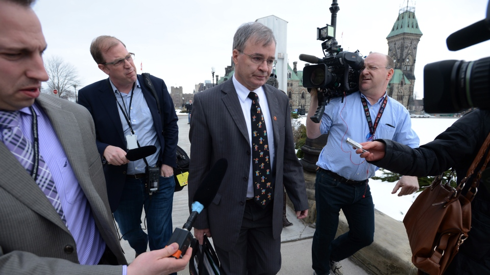 Nunavut Senator Dennis Patterson is questioned by reporters as he leaves the Senate entrance on Parliament Hill in Ottawa on Tuesday Feb 26, 2013. (Sean Kilpatrick/THE CANADIAN PRESS)