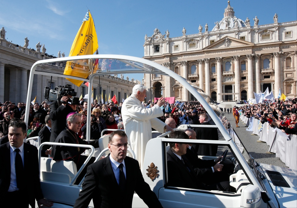 Pope Benedict XVI waves as he arrives in St. Peter's Square at the Vatican, Wednesday, Feb. 27, 2013. (AP / Michael Sohn)