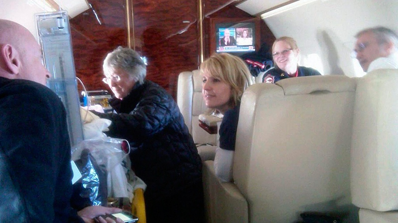 Gloria Giffords, Congresswoman Gabrielle Giffords' mother, centre, talks with her daughter aboard the plane transporting her from Tucson to Houston. (AP / Congresswoman Gifford' Office)