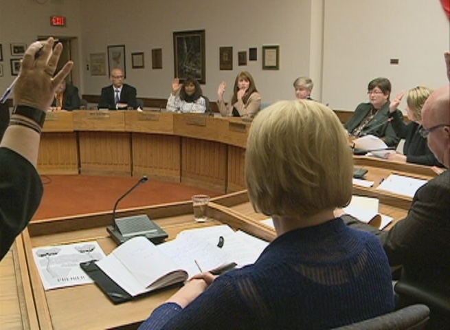 Public school board trustees vote in favour of replacing Connaught school at a meeting Tuesday night.