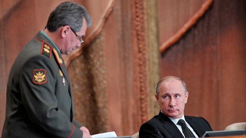 Russian President Vladimir Putin, right, and Defense Minister Sergei Shoigu attend a meeting with top military officials in Moscow, Wednesday, Feb. 27, 2013. (AP Photo / RIA Novosti, Alexei Nikolsky, Presidential Press Service)