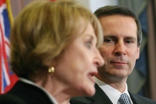 Ontario Premier Dalton McGuinty, right, listens as Rep. Louise Slaughter, D-N.Y., speaks at the U.S. Chamber of Commerce in Washington, Tuesday, Feb. 27, 2007, during a news conference regarding Canadian-U.S. border. (AP / Lauren Victoria Burke)