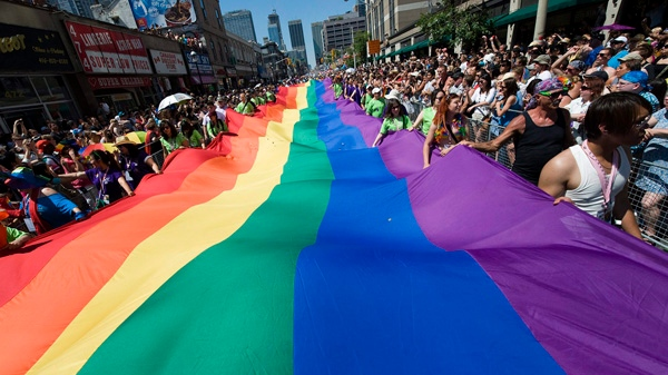 People take part in the Pride Parade in Toronto on Sunday, July 4, 2010. (Adrien Veczan/THE CANADIAN PRESS)