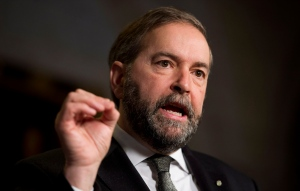 NDP leader Tom Mulcair speaks with the media in the foyer of the House of Commons,  in Ottawa, Wednesday, Feb. 27, 2013. (Adrian Wyld / THE CANADIAN PRESS)
