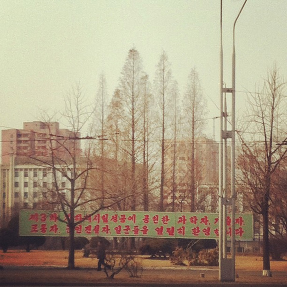 In this photo posted on Instagram, a man walks in Pyongyang, North Korea, under a new roadside banner referring to North Korea's controversial Feb. 12 nuclear test Monday, Feb. 25, 2013. Tweeting and uploading to Instagram is pretty ordinary stuff in the world of social media, but revolutionary for North Korea. (AP/Jean H. Lee)