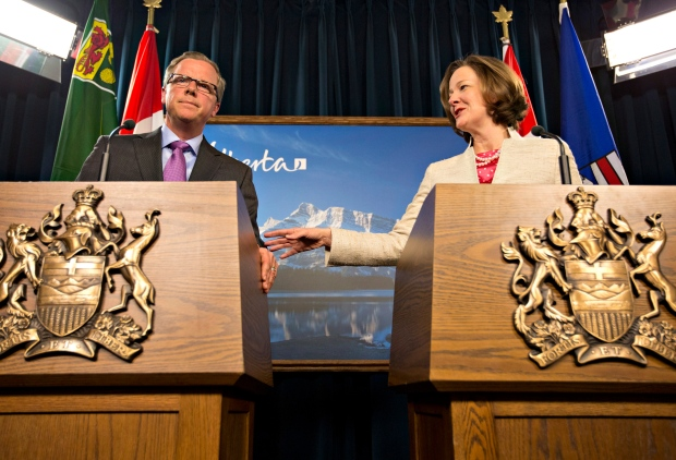 Brad Wall and  Alison Redford