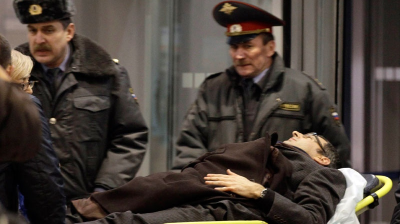 A man wounded in a blast is evacuated from Domodedovo Airport in Moscow, Monday, Jan. 24, 2011. (AP / Ivan Sekretarev)