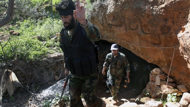 A Free Syrian Army fighter leaves with rebels