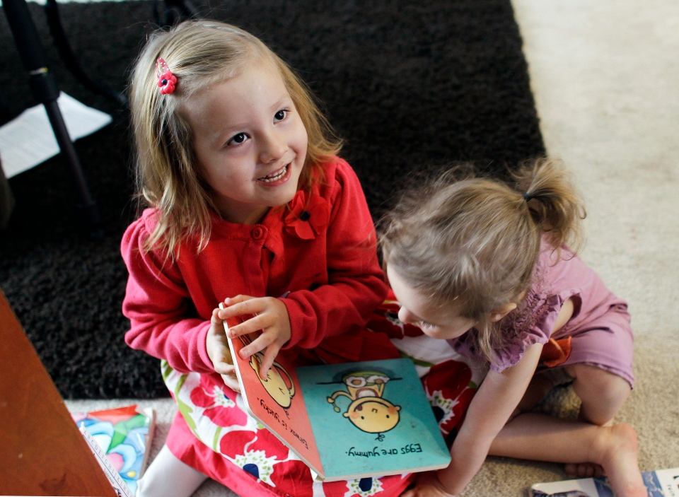 In this Monday, Feb. 25, 2013, photo, Coy Mathis, left, plays with sister Auri at their home in Fountain, Colo. (AP Photo/Brennan Linsley)