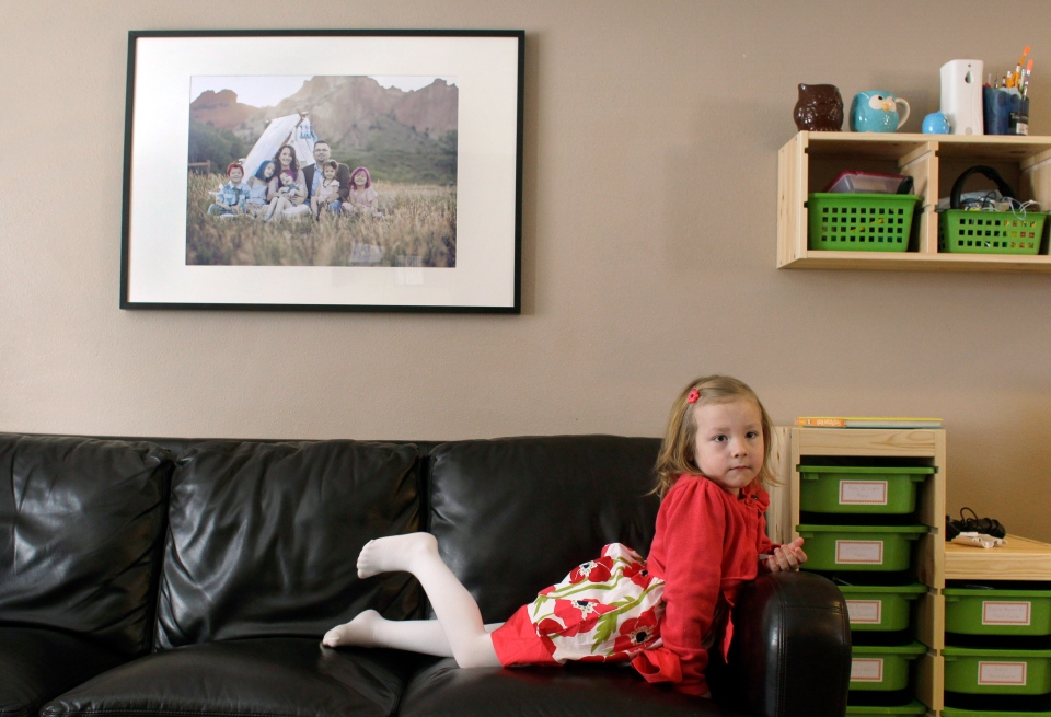 In this Monday, Feb. 25, 2013, photo, Coy Mathis sits on a couch at her home in Fountain, Colorado. (AP Photo/Brennan Linsley)