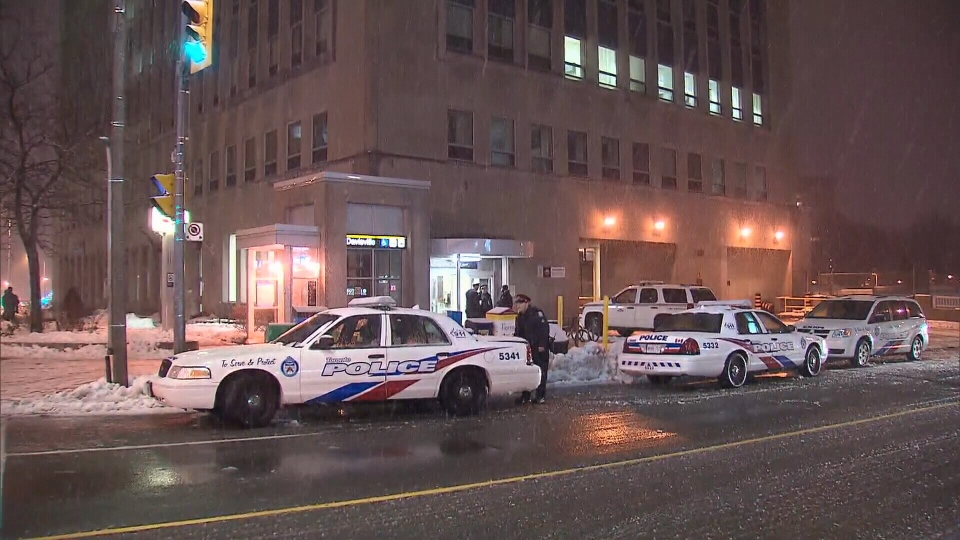 Police investigate outside Davisville subway station after a man was stabbed on a train, Wednesday, Feb. 27, 2013.