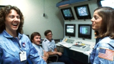 In this 1986 file photo, Christa McAuliffe, left, and Barbara Morgan, right, laugh during training. (AP Photo/NASA, File)