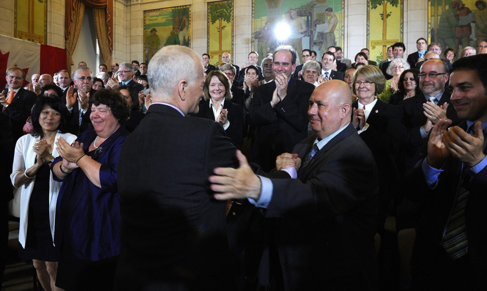 MP Claude Patry shakes hands with former NDP leader Jack Layton in this May 2011 file photo. (Sean Kilpatrick/THE CANADIAN PRESS)
