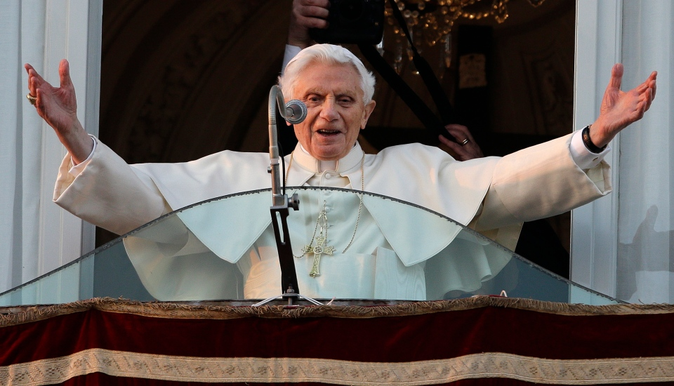 Pope Benedict XVI greets the crowd from the window of the Pope's summer residence of Castel Gandolfo, Thursday, Feb. 28, 2013. (AP / Andrew Medichini)