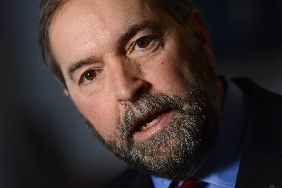 Thomas Mulcair holds a scrum in the House of Commons Foyer in Ottawa, Thursday, Feb. 28, 2013. (Seak Kilpatrick / THE CANADIAN PRESS)