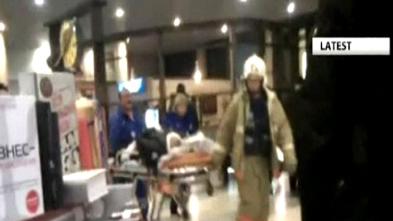 In this image made from video, a victim is wheeled from Moscow's Domodedovo Airport, after an explosion ripped through the international arrivals hall Monday, Jan. 24, 2011. (AP Photo)