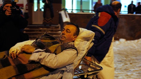 A wounded blast victim is brought by rescuers to a hospital from Domodedovo airport in Moscow, Monday, Jan. 24, 2011. (AP/Alexander Zemlianichenko)