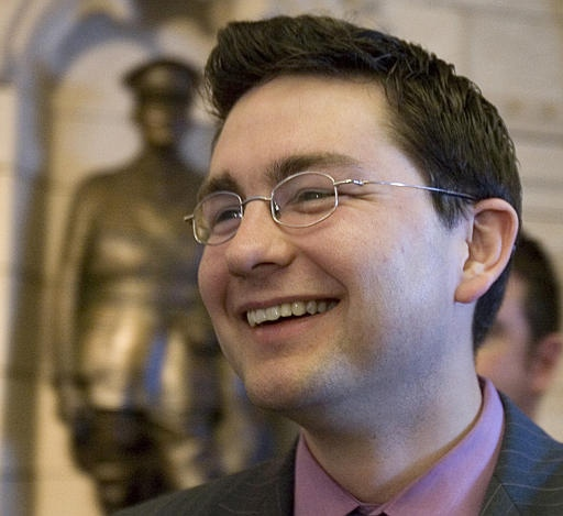 Ottawa-area Conservative MP Pierre Poilievre smiles as he talks with reporters on Parliament Hill in Ottawa Tuesday Feb. 27, 2007. (CP / Tom Hanson)
