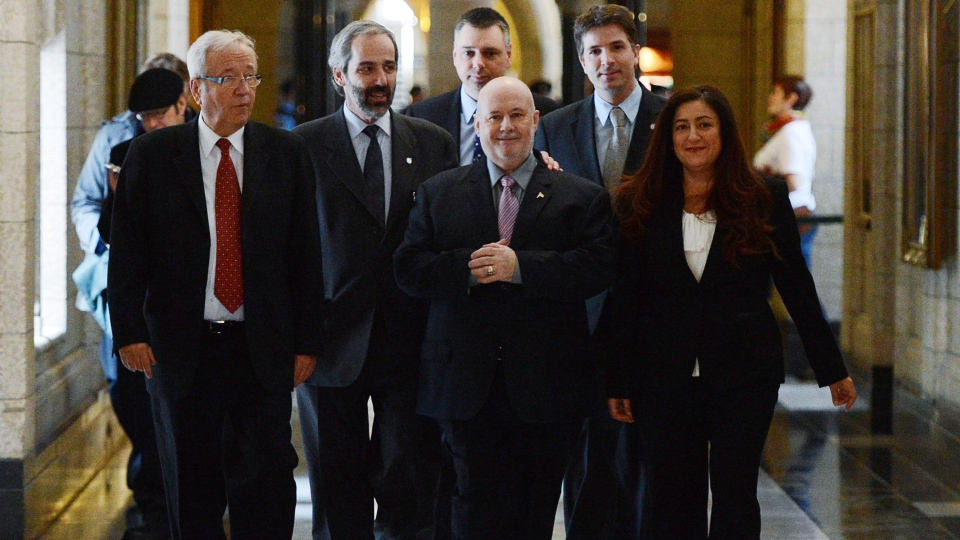 MP Claude Patry, middle front, walks with Bloc Quebecois members Louis Plamondon, left to right, Daniel Paille Andrv Bellavance, Franvßois Fortin and Maria Mourani as they make their way to the House of Commons on Parliament Hill in Ottawa on Thursday, Feb 28, 2013. (Sean Kilpatrick / THE CANADIAN PRESS)