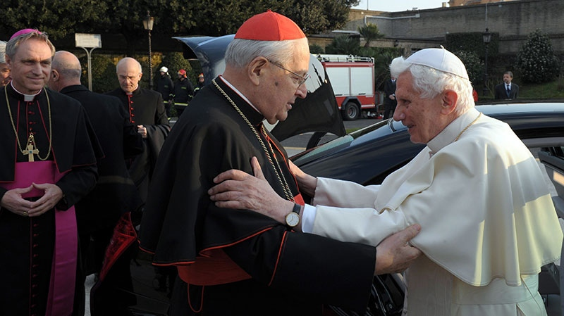 Then Pope Benedict XVI is saluted by Cardinal Angelo Sodano, Dean of the College of Cardinals, left, as leaves the Vatican to board helicopter where he will depart to the pontiff's summer residence of Castel Gandolfo, Thursday, Feb. 28, 2013. (L'Osservatore Romano)