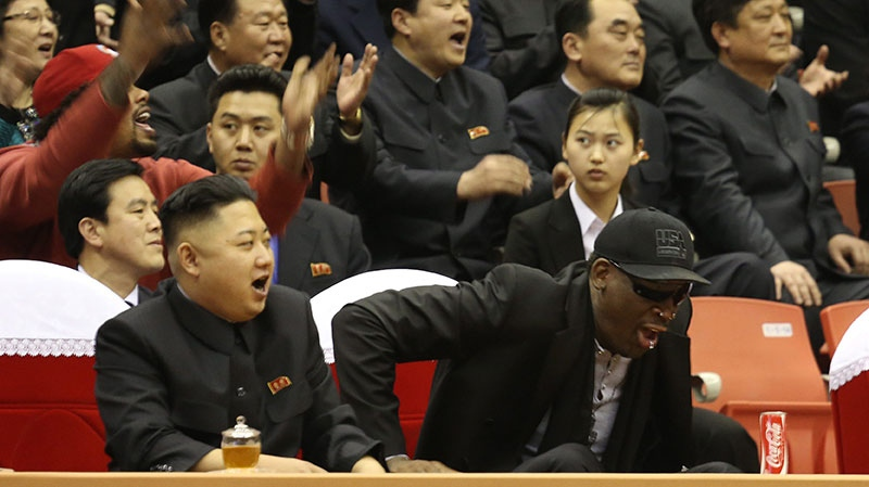 North Korean leader Kim Jong Un, left, and former NBA star Dennis Rodman watch North Korean and U.S. players in an exhibition basketball game at an arena in Pyongyang, North Korea, Thursday, Feb. 28, 2013. (VICE Media /  Jason Mojica)