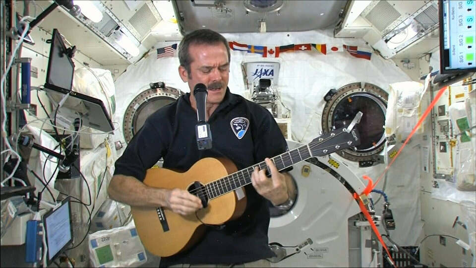 Canadian astronaut Chris Hadfield plays the guitar from the International Space Station for Canada AM, Thursday, Feb. 28, 2013.