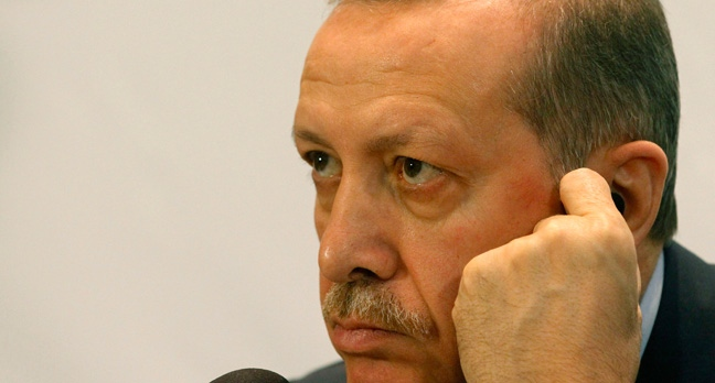 Turkish Prime Minister Recep Tayyip Erdogan listens at a press conference during the 5th Global Forum of the United Nations Alliance of Civilizations at the Hofburg palace, in Vienna, Austria, Wednesday, Feb. 27, 2013. (AP Photo/Ronald Zak)