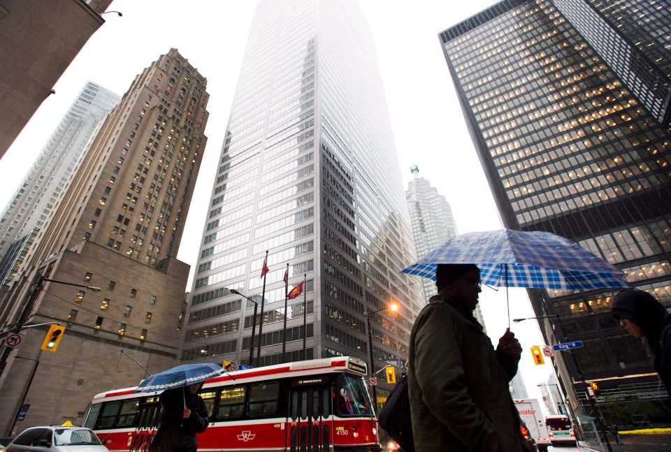 Pedestrians walk in Toronto's financial district on Oct. 29, 2012. (Nathan Denette / THE CANADIAN PRESS)