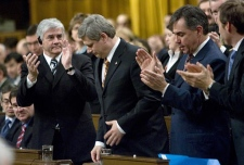 Prime Minister Stephen Harper receives a standing ovation from caucus members after voting in favour of extending the anti-terrorism act in the House of Commons on Parliament Hill in Ottawa Tuesday Feb. 27, 2007.  (CP / Tom Hanson)