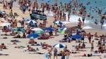 <b>Must-see:</b> Bondi Beach <br> Bondi Beach is known as one of the world's great beaches with an opportunity to learn how to surf. <br><br> (AP / Rick Rycroft)