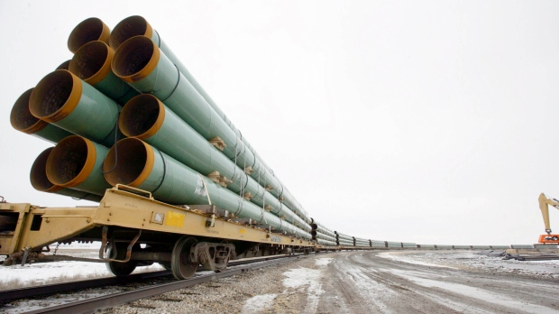 Rail cars arrive loaded with pipe for the first Keystone Pipeline project in Milton, N.D., on Feb. 28, 2008. (Grand Forks Herald / Eric Hylden)