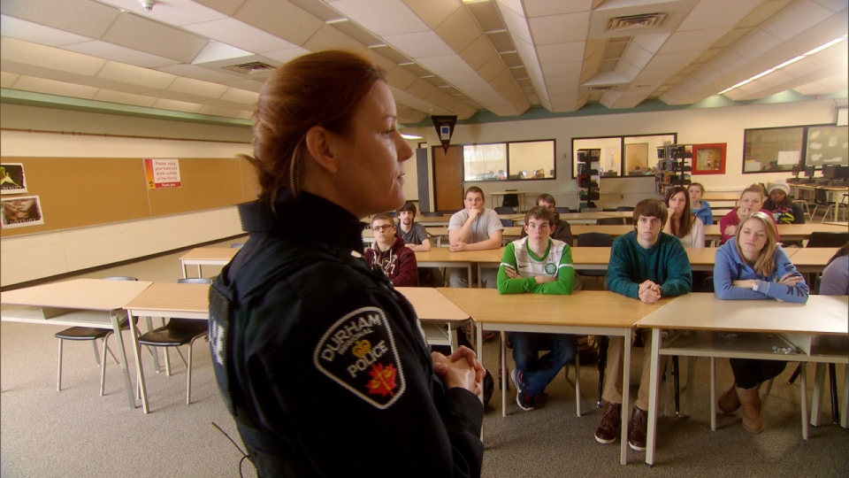 Durham Police Const. Sarah Foote speaks to a school class (W5).