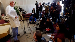 Cook County Medical Examiner Dr. Stephen Cina speaks at a news conference in Chicago, Friday, Jan . 18, 2013, regarding the exhumation earlier in the day of Urooj Khan, 46, who died in July of cyanide poisoning after winning the lottery. (AP / Nam Y. Huh)