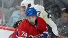 Montreal Canadiens' Alexei Emelin (74) checks Pittsburgh Penguins' Sidney Crosby into the boards during first period NHL hockey action in Montreal, Saturday, March 2, 2013. THE CANADIAN PRESS IMAGES/Graham Hughes.