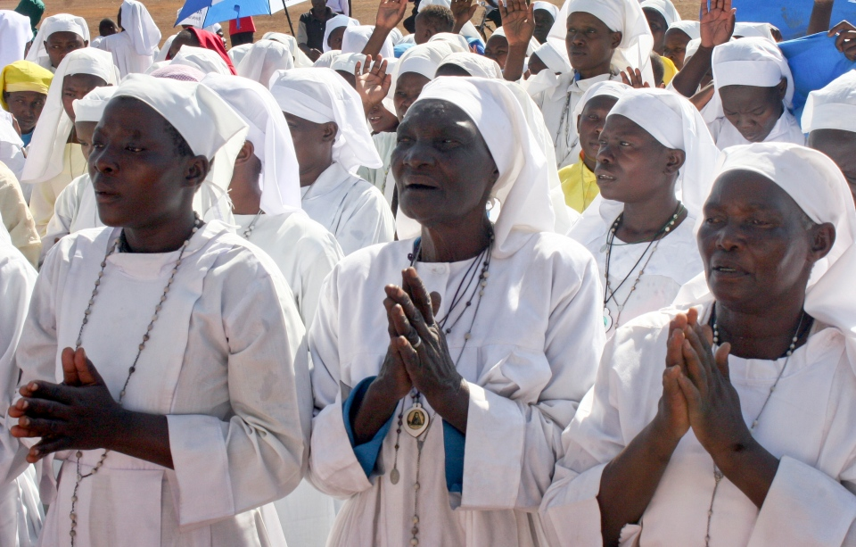 Members of the Legio Maria religious movement pray for a peaceful election in Kisumu, Kenya Sunday, March 3, 2013. (AP Photo)