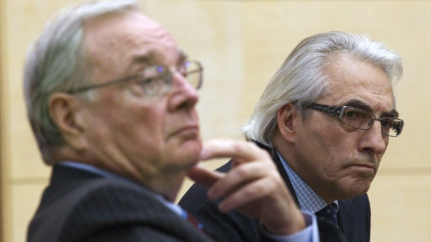 Chief Phil Fontaine (right) and Former Prime Minister Paul Martin listen to a question during a discussion on Indigenous governance in a new century at Ryerson University in Toronto on Tuesday January 25, 2011. (THE CANADIAN PRESS/Frank Gunn)