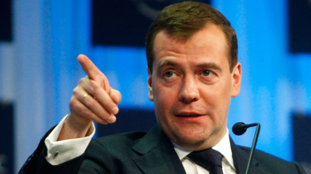 Russian President Dmitry Medvedev gestures while speaking during the opening address at the World Economic Forum in Davos, Switzerland on Wednesday, Jan. 26, 2011. (AP / Michel Euler)